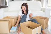 Woman unpacking boxes — Stock Photo