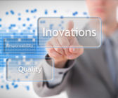 Man clicking on the innovations button — Stock Photo