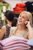 Woman is phoning while laughing — Stock Photo