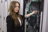 Girl working on mounted rack servers — Stock Photo
