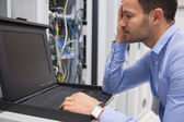 Man running diagnostics of servers — Stock Photo