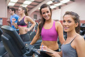 Happy women in the gym during assessment — Stock Photo