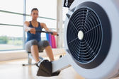 Rowing machine being used — Stock Photo