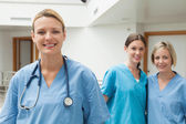 Two nurses in the background and one in the foreground — Stock Photo