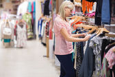 Woman looking at clothes — Stock Photo