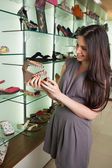 Woman looking at shoes — Stock Photo