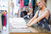 Woman standing behind the counter of the shop — Stock Photo