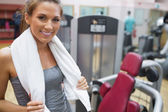 Smiling woman with towel around shoulders — Stock Photo