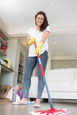 Woman mopping the floor — Stock Photo