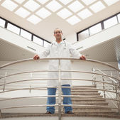 Doctor looking down from stairwell — Stock Photo