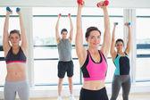 Women lifting weights — Stockfoto