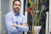 Man standing with arms crossed in data center — Stock Photo