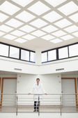 Doctor standing in stairwell — Stock Photo