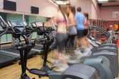 Working out on on step machines at speed — Stock Photo
