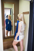 Woman standing in front of a mirror — Stock Photo