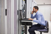 Man maintaining the servers — Stock Photo