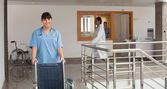 Doctors assistant pushing a wheelchair — Stock Photo