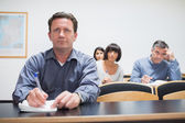 Students listening and writing — Stock Photo