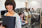 Teacher smiling in computer class — Stock Photo