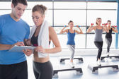 Women doing aerobics while trainer talking to woman — Stock Photo