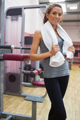Smiling woman in a fitness studio — Stock Photo