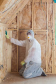 Worker insulating walls — Stock Photo