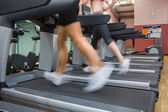 Two running on treadmills in the gym — Stock Photo