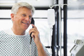 Patient on payphone — Stock Photo