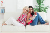 Woman showing friend a magazine — Stock Photo