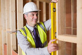 Architect measuring wood frame — Foto Stock