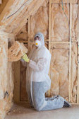 Worker filling walls with insulation — Stock Photo