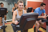 Smiling woman in spin class — Stock Photo
