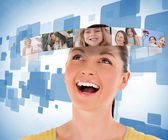 Smiling woman looking at picture bar — Stock Photo