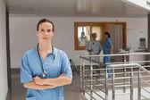 Doctor standing in the hallway — Stock Photo
