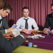 Men playing high stakes poker game — Stock Photo #23086564