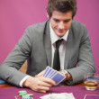Mplaying poker in casino — Stock Photo #23086670