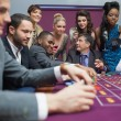 Women watching men play roulette — Stock Photo