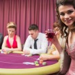 Womsmiling at poker table — Stock Photo #23086756