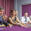 Smiling group at poker table — Stock Photo #23086854