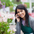 Smiling florist outside the garden centre — Stock Photo #23086944
