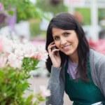 Smiling florist outside the garden centre — Stock Photo