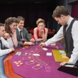 Playing poker in a casino — Stock Photo