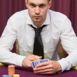 Man sitting at poker table — Stock Photo #23087450
