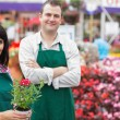 Two smiling garden center employees — Stock Photo #23087690