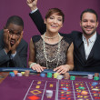 Two winners and a loser at roulette - Stock Photo