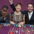 Foto Stock: Two winners and loser at roulette