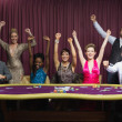 Cheering group at poker table — Stock Photo