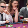 Men and woman sitting at poker table — Stock Photo