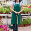 Florist holding a spade — Stock Photo