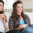 Two girls holding cups of coffee — Stock Photo